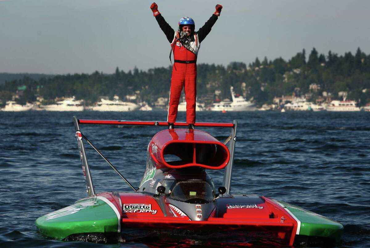 Driver Steve David stands atop the Oh Boy! Oberto Unlimited Hydroplane as he wins the 2012 Albert Lee Cup at Seafair during the annual air show, festival and boat races on Sunday, August 5, 2012 on Lake Washington.