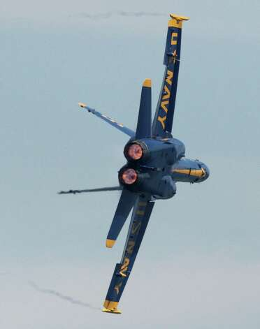 One of the U.S. Navy Blue Angels screams over Lake Washington during Seafair on Sunday, August 5, 2012 over Lake Washington. Photo: JOSHUA TRUJILLO / SEATTLEPI.COM