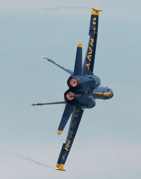 One of the U.S. Navy Blue Angels screams over Lake Washington during Seafair on Sunday, August 5, 20