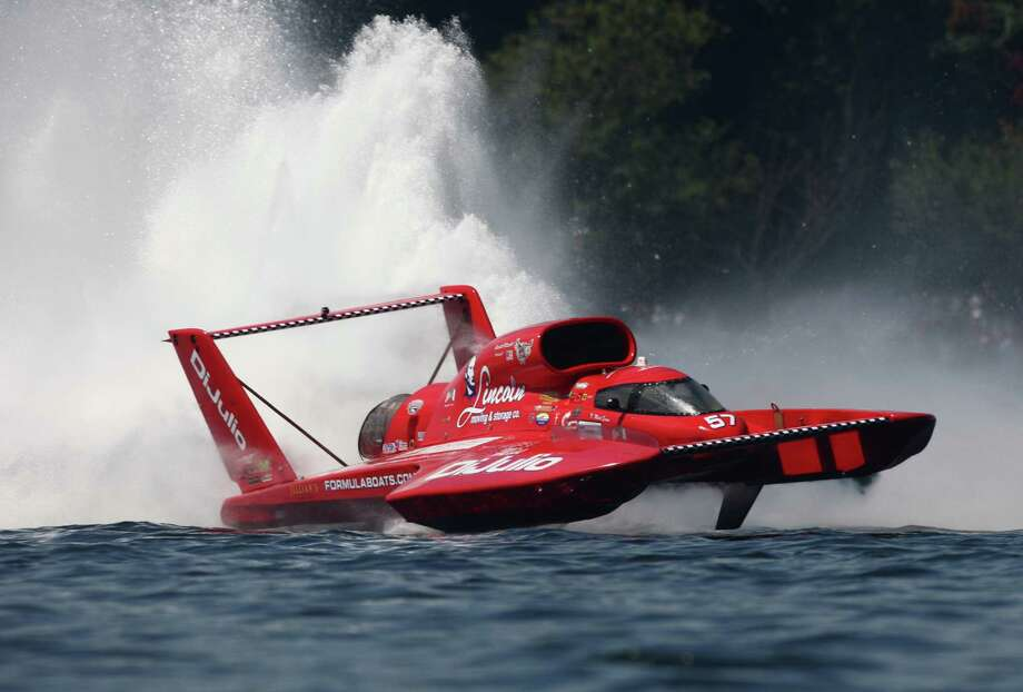 Driver N. Mark Evans in the Miss DiJulio gets some air during Heat 3B of the Unlimited Hydroplane races during Seafair on Sunday, August 5, 2012 on Lake Washington. Photo: JOSHUA TRUJILLO / SEATTLEPI.COM