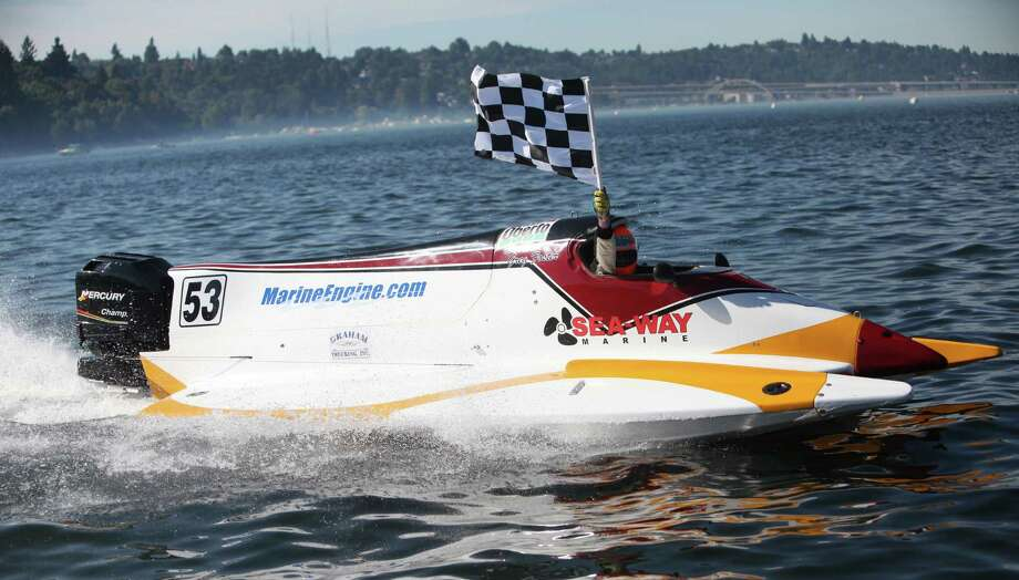Greg Foster waves the checkered flag as he wins the F1 Prop Tour Final during Seafair on Sunday, August 5, 2012 on Lake Washington. Photo: JOSHUA TRUJILLO / SEATTLEPI.COM