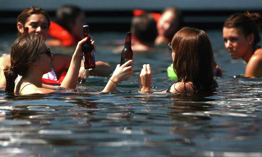 People try to cool off in the cool water of Lake Washington during Seafair on Sunday, August 5, 2012 on Lake Washington. Photo: JOSHUA TRUJILLO / SEATTLEPI.COM