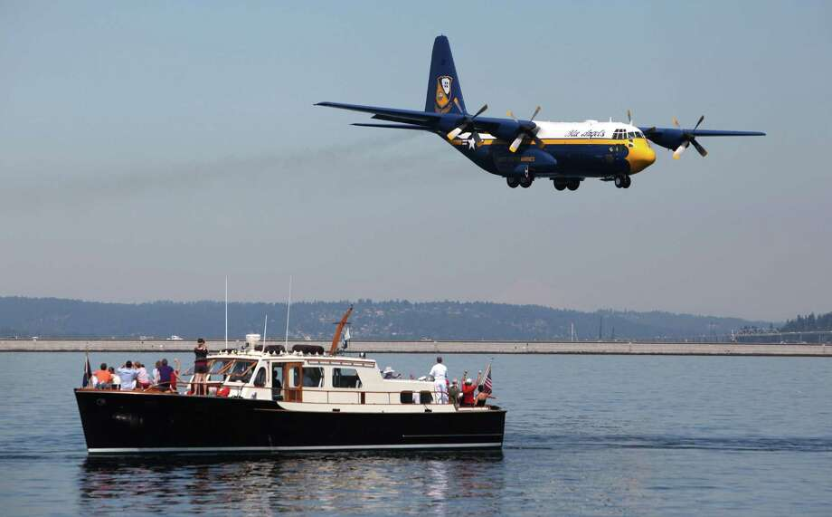 The U.S. Navy's Fat Albert C-130 flies low over Lake Washington during Seafair on Sunday, August 5, 2012 on Lake Washington. Photo: JOSHUA TRUJILLO / SEATTLEPI.COM