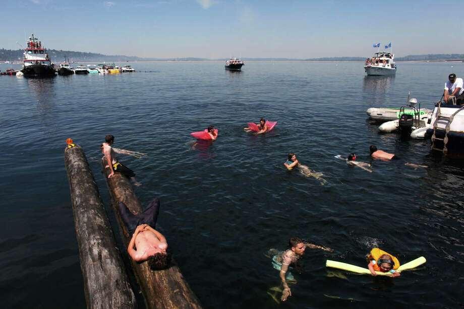 People cool off in the water near the Log Boom during Seafair on Sunday, August 5, 2012 on Lake Washington. Photo: JOSHUA TRUJILLO / SEATTLEPI.COM