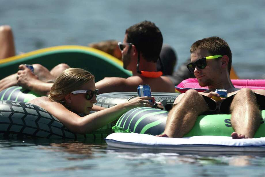People float on Lake Washington during Seafair on Sunday, August 5, 2012 on Lake Washington. Photo: JOSHUA TRUJILLO / SEATTLEPI.COM