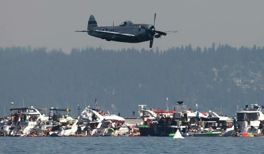 An airplane from the Flying Heritage Collection flies over Lake Washington during Seafair on Sunday, August 5, 2012 on Lake Washington. Photo: JOSHUA TRUJILLO / SEATTLEPI.COM