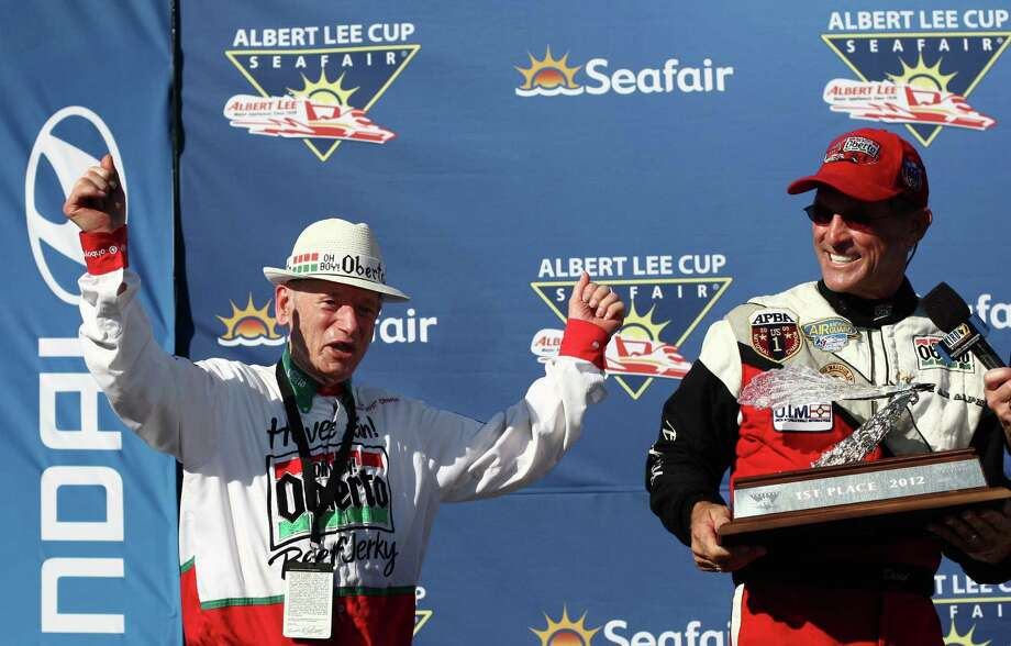 Art Oberto celebrates with driver Steve David after David won the Albert Lee Cup at Seafair. Photo: JOSHUA TRUJILLO / SEATTLEPI.COM