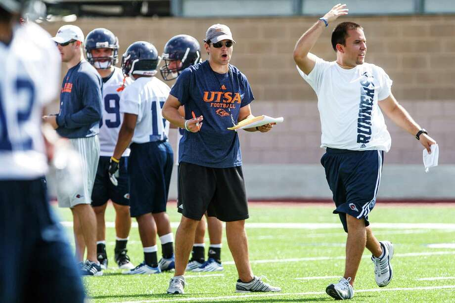 UTSA offensive coordinator Keven Brown (center) reacts to a play during the first day of fall practice for the UTSA Roadrunners at Dub Farris Stadium on Aug. 5, 2012.  MARVIN PFEIFFER/ mpfeiffer@express-news.net Photo: MARVIN PFEIFFER, Express-News / Express-News 2012