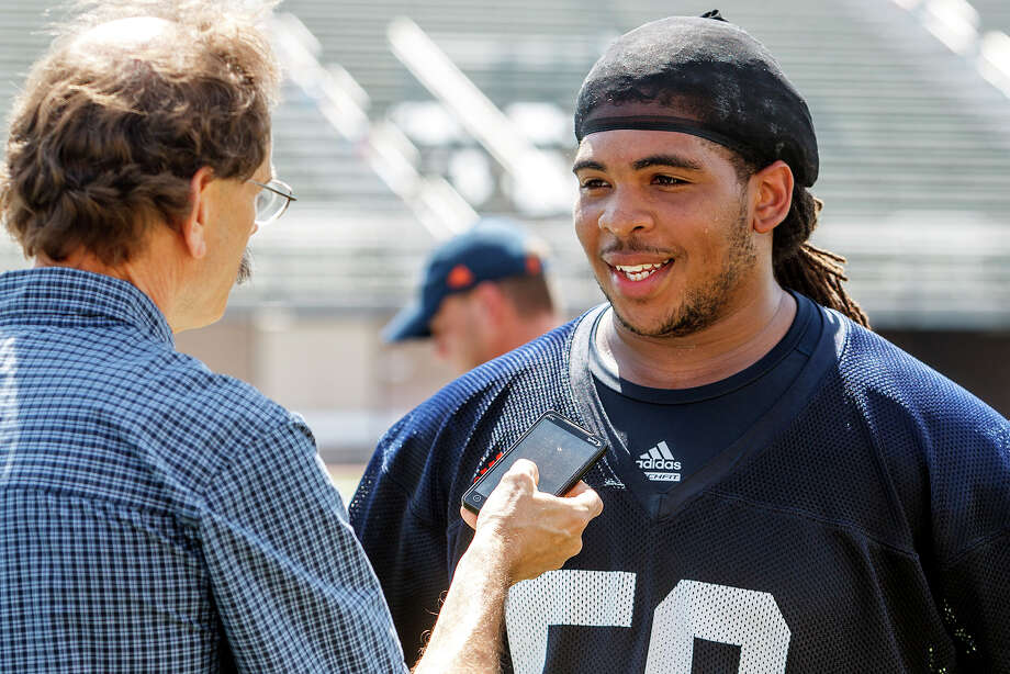 Sophomore defensive tackle Ferrington Macon speaks to Express-News reporter Jerry Briggs following the first day of fall practice for the UTSA Roadrunners at Dub Farris Stadium on Aug. 5, 2012.  MARVIN PFEIFFER/ mpfeiffer@express-news.net Photo: MARVIN PFEIFFER, Express-News / Express-News 2012