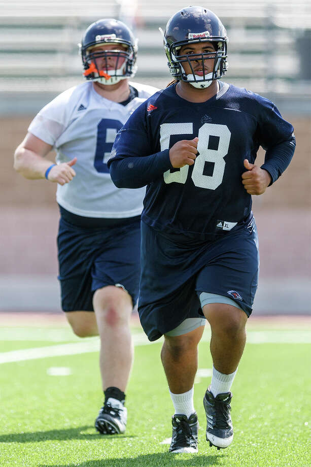 UTSA's Ferrington Macon (right) and Cody Kaleh run sprints at the end of the first day of fall practice for the UTSA Roadrunners at Dub Farris Stadium on Aug. 5, 2012.  MARVIN PFEIFFER/ mpfeiffer@express-news.net Photo: MARVIN PFEIFFER, Express-News / Express-News 2012