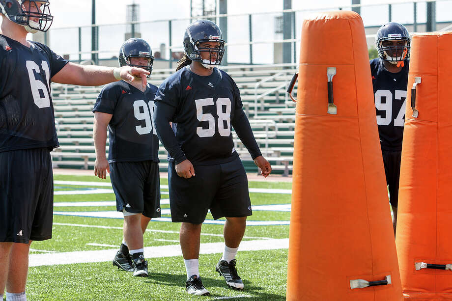 UTSA defensive linemen Richard Burge (from left) Leighton Gilbert, Ferrington Macon and Ashaad Mabry work on alignment responsibilites during the first day of fall practice for the UTSA Roadrunners at Dub Farris Stadium on Aug. 5, 2012.  MARVIN PFEIFFER/ mpfeiffer@express-news.net Photo: MARVIN PFEIFFER, Express-News / Express-News 2012