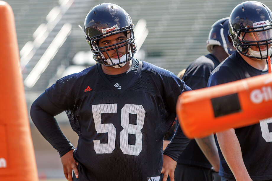 Sophomore defensive tackle Ferrington Macon (center) listens to instructions during defensive line drills during the first day of fall practice for the UTSA Roadrunners at Dub Farris Stadium on Aug. 5, 2012.  MARVIN PFEIFFER/ mpfeiffer@express-news.net Photo: MARVIN PFEIFFER, Express-News / Express-News 2012