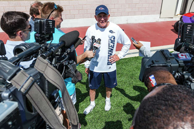 UTSA head coach Larry Coker talks to reporters at the end of the first day of fall practice for the UTSA Roadrunners at Dub Farris Stadium on Aug. 5, 2012.  MARVIN PFEIFFER/ mpfeiffer@express-news.net Photo: MARVIN PFEIFFER, Express-News / Express-News 2012