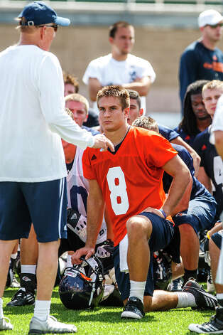 UTSA quarterback Eric Soza (8) listens attentively as head coach Larry Coker address the team during the first day of fall practice for the UTSA Roadrunners at Dub Farris Stadium on Aug. 5, 2012.  MARVIN PFEIFFER/ mpfeiffer@express-news.net Photo: MARVIN PFEIFFER, Express-News / Express-News 2012