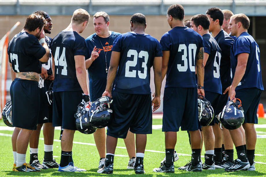 UTSA defensive coordinator Neal Neathery (fourth from left) speaks to his defense after the first day of fall practice for the Roadrunners at Dub Farris Stadium on Aug. 5, 2012.  MARVIN PFEIFFER/ mpfeiffer@express-news.net Photo: MARVIN PFEIFFER, Express-News / Express-News 2012
