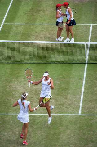 Russia's Maria Kirilenko and Nadia Petrova, bottom, celebrate their 4-6, 6-4, 6-1 victory as Liezel Huber, top right, and Lisa Raymond shake hands after the bronze-medal match. Photo: Smiley N. Pool / © 2012  Houston Chronicle