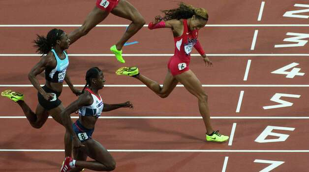 Sanya Richards-Ross, a former Texas Longhorn, outpaces the field to win the women's 400-meter final in 49.55 seconds. It was the first track and field gold medal for the U.S. this year. Photo: Smiley N. Pool / © 2012  Houston Chronicle