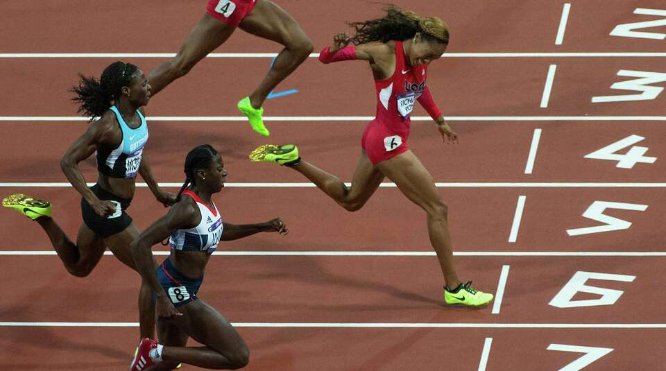 Sanya Richards-Ross, a former Texas Longhorn, outpaces the field to win the women's 400-meter final