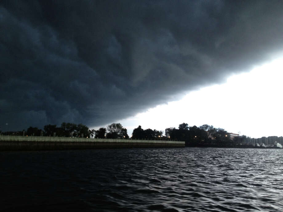 Storm clouds roll in over Stamford Harbor on Sunday, Aug. 5, 2012. Photo: Manuel Estrada / Connecticut Post