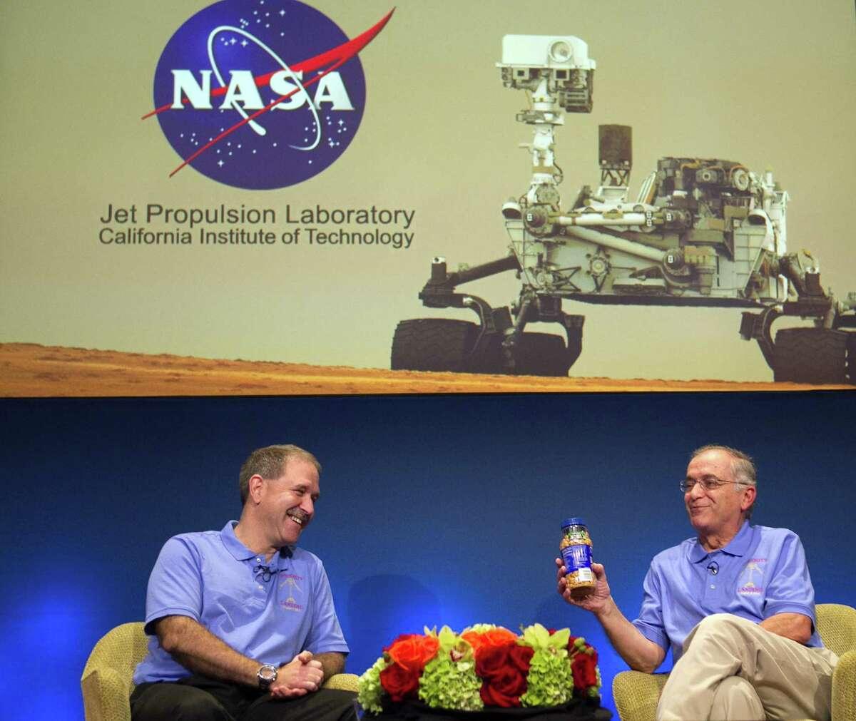 John Grunsfeld, NASA Associate Administrator, NASA Headquarters, left, and Charles Elachi, JPL Director, NASA Jet Propulsion Laboratory, present a can of