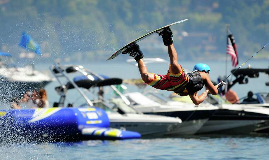 Wakeboarder Trever Maur catches some air as he performs at the Hyperlite Wakeboard Experience Semi-Finals on Lake Washington during Seafair. Photo: LINDSEY WASSON / SEATTLEPI.COM