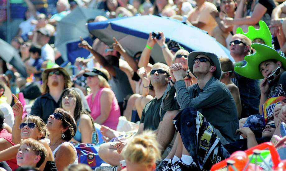 Thousands of people look into the sky as the Blue Angels perform over Lake Washington. Photo: LINDSEY WASSON / SEATTLEPI.COM