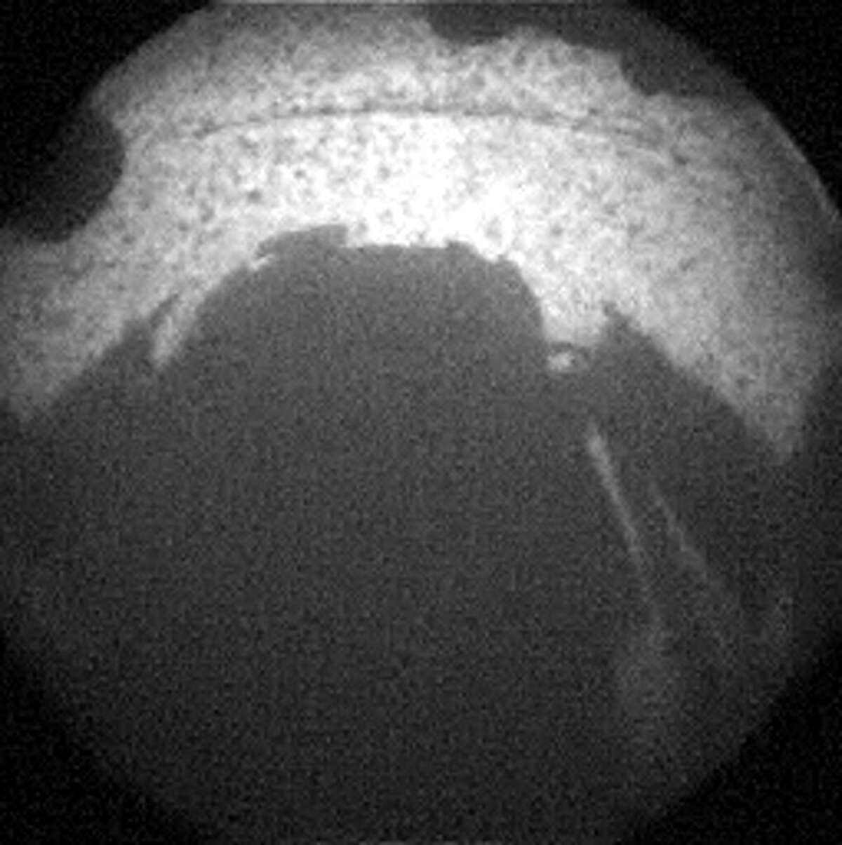 This is one of the first images taken by NASA's Curiosity rover, which landed on Mars early Monday, Aug. 6, 2012, CT. It was taken through a