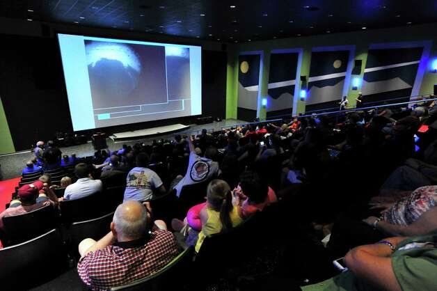Hundreds watch the  images from Mars on the big screen as they watch NASA's Mars Curiosity rover land on Mars during a special viewing event at the U.S. Space and Rocket Center Monday, August 6, 2012 in Huntsville, Ala.  (AP Photo/The Huntsville Times, Eric Schultz) Photo: Eric Schultz