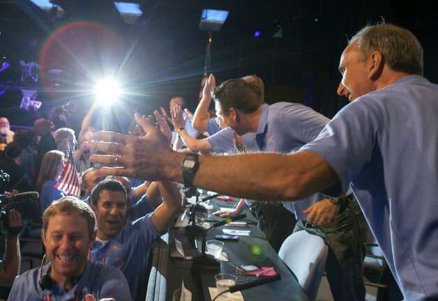 Mars Science Laboratory Curiosity team members celebrate the landing of Curiosity rover on the surface of Mars at NASA's Jet Propulsion Laboratory in Pasadena, Calif., Sunday, August 5, 2012. (AP Photo/Damian Dovarganes) Photo: Damian Dovarganes