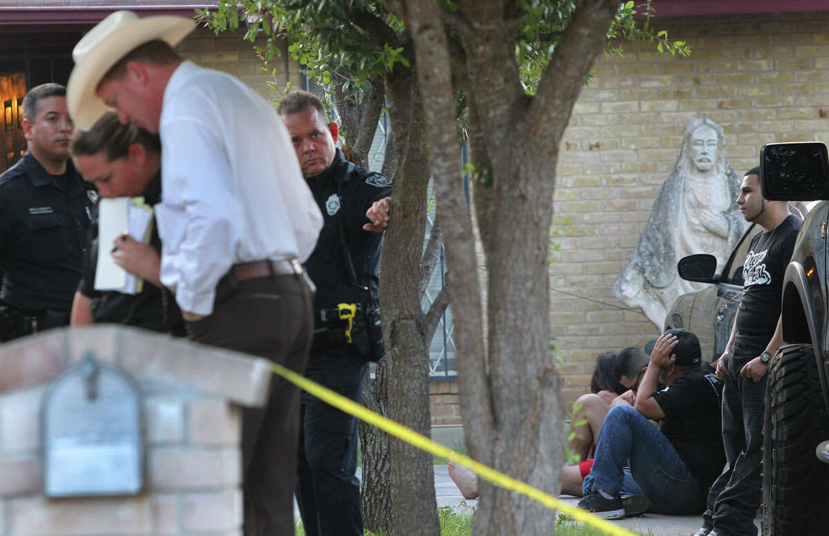 Officials from the Bexar County Sheriff's Office investigate the scene where a deputy involved shooting took place about 4:00 a.m. Monday August 6, 2012 during a party at 2306 Marilyn Kay on San Antonio's Northwest Side. According to detective Louis Antu, a detention officer was accidentally shot in the hand with a shotgun during a party at the house and was taken to an area hospital. The investigation is ongoing. John Davenport/©San Antonio Express-News