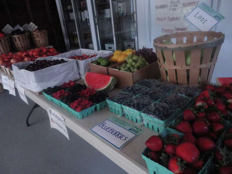 An array of fresh fruit, including locally grown berries, fill a table at the farm stand. Photo: Contributed Photo, Nicoletta Richardson / Contribut / Fairfield Citizen contributed