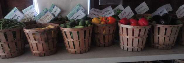 Fresh vegetrables in baskets line a shelt in the Greenfield Farms stand on Congress Street. Photo: Contributed Photo, Nicoletta Richardson / Contribut / Fairfield Citizen contributed
