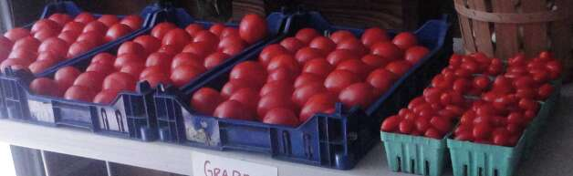 A variety of tomatoes on sale inside the farm stand. Photo: Contributed Photo, Nicoletta Richardson / Contribut / Fairfield Citizen contributed