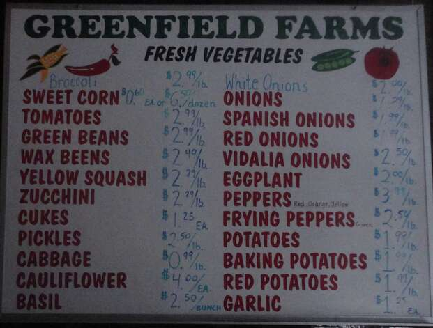 Prices for produce staples are are displayed inside the shop at Greenfield Farms. Photo: Nicoletta Richardson / Contribut