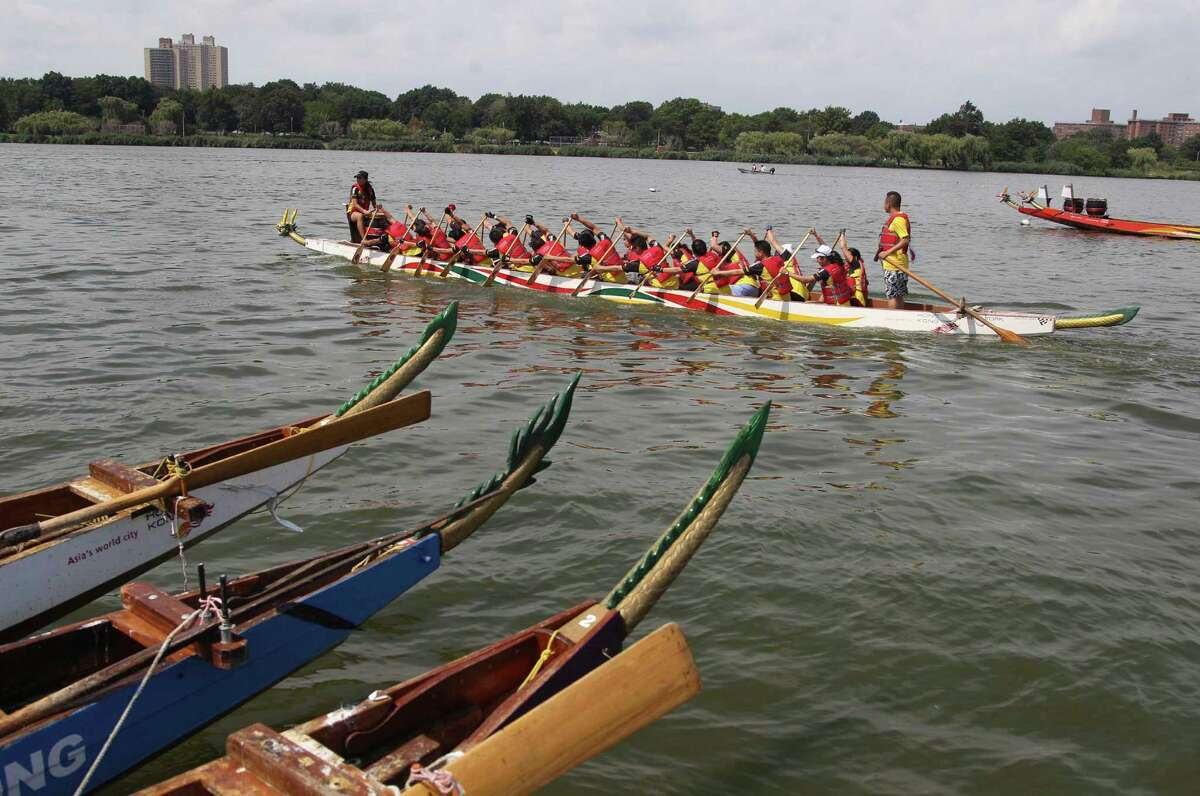 A boat moves into position for the start of a race during the Hong Kong Dragon Boat Festival in the Queens section of New York, Sunday, Aug. 5, 2012. The annual Hong Kong Dragon Boat Festival in Queens drew more than 180 teams Sunday, paddling aboard painted boats.