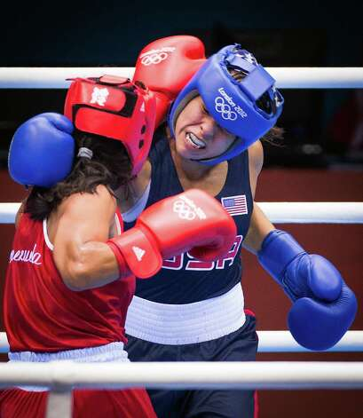 Marlen Esparza of the USA, in blue, fights Venezuela's Karlha Magliocco in a women's flyweight 51-kg quarterfinal boxing match at the 2012 London Olympics on Monday, Aug. 6, 2012. With a victory in the bout, Esparza, is guaranteed of no less than a bronze medal. Photo: Smiley N. Pool, Houston Chronicle / © 2012  Houston Chronicle