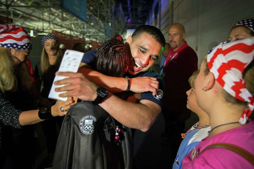 Marlen Esparza gets a hug from her coach Rudy Silva as friends and family celebrate her victory over