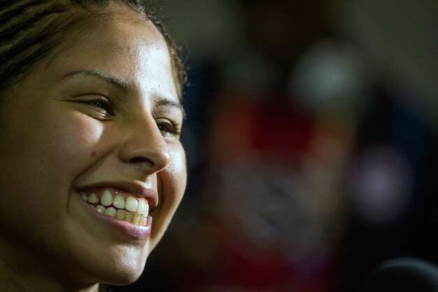 Boxer Marlen Esparza beams a smiley while doing a television interview after deferring Venezuela's Karlha Magliocco in a women's flyweight 51-kg quarterfinal boxing match at the 2012 London Olympics on Monday, Aug. 6, 2012. With a victory in the bout, Esparza, is guaranteed of no less than a bronze medal. Photo: Smiley N. Pool, Houston Chronicle / © 2012  Houston Chronicle