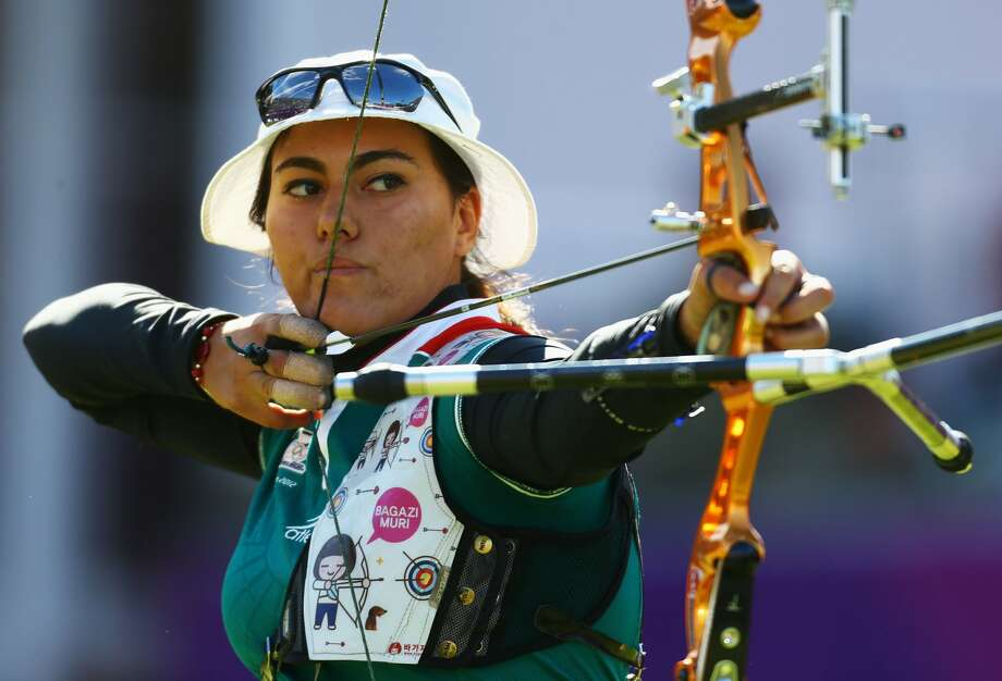 Archery first appeared in the Olympic Games in 1900 and was contested again in 1904, 1908 and 1920. After an absence of 52 years, it returned in 1972. Here, Alejandra Valencia, 17, of Mexico, competes at the London 2012 Olympic Games.  (Paul Gilham / Getty Images)