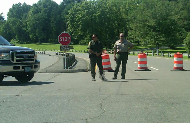 Police block entrance to Sherwood Island State Park on Monday morning, which has been closed for the day for helicopter and security staging area for President Obama's visit to town Monday night to attend fundraiser at the home of movie producer Harvey Weinstein on Beachside Avenue. Photo: Nicoletta Richardson / Westport News contributed