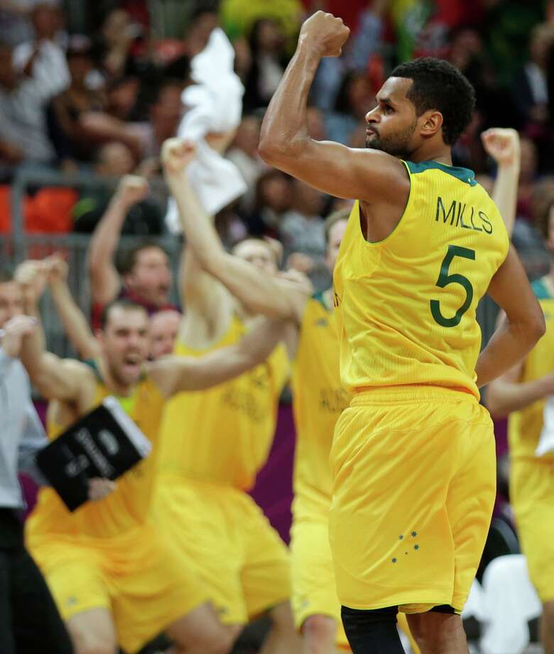 Australia's Patrick Mills pumps his fist after hitting the game-winning 3-point shot to pull ahead of Russia with time expiring during a men's basketball game at the 2012 Summer Olympics, Monday, Aug. 6, 2012, in London.(AP Photo/Charles Krupa) Photo: Charles Krupa, Associated Press / AP
