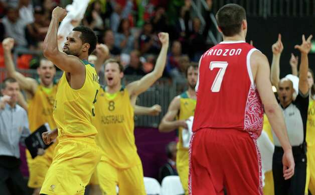 Australia's Patrick Mills pumps his fist after hitting the game-winning 3-point shot to pull ahead of Russia with time expiring during a men's basketball game at the 2012 Summer Olympics, Monday, Aug. 6, 2012, in London. At right is Russia's Vitaliy Fridzon. (AP Photo/Charles Krupa) Photo: Charles Krupa, Associated Press / AP