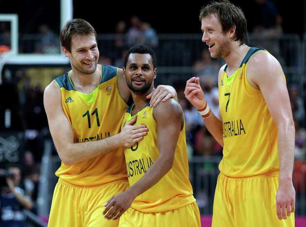 Australia's Patrick Mills (5) celebrates with teammates MarkWorthington and Joe Ingles (7) after scoring a last second basket in the team's win over Russia in a preliminary men's basketball game at the 2012 Summer Olympics, Monday, Aug. 6, 2012, in London. (AP Photo/Eric Gay) Photo: Eric Gay, Associated Press / AP
