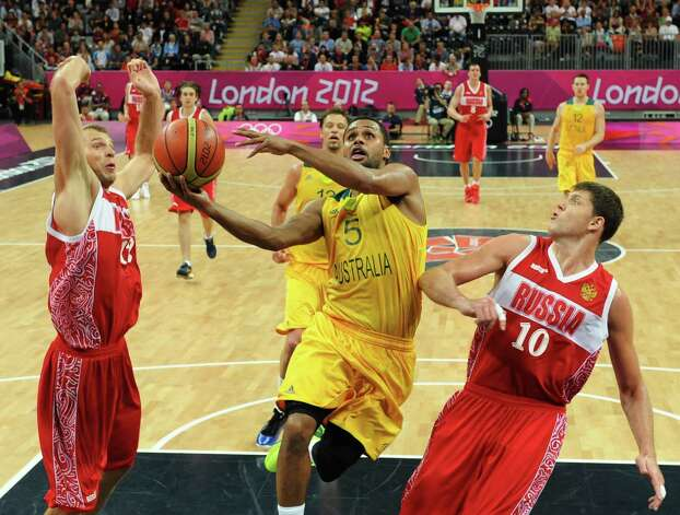 Australia's Patrick Mills (5) shoots to score against Russia's Victor Khryapa during their men's basketball game at the 2012 Summer Olympics, Monday, Aug. 6, 2012, in London. (AP Photo/Mark Ralston, Pool) Photo: Mark Ralston, Associated Press / Pool AFP