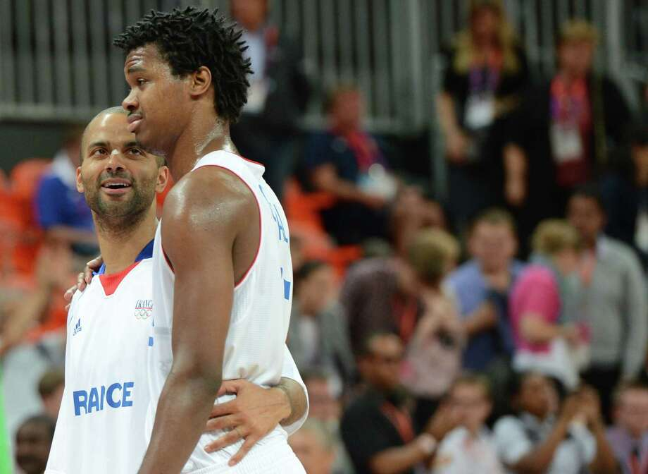 French forward Mickael Gelabale (R) and French guard Tony Parker speak after winning the men's basketball preliminary round match France vs Nigeria as part of the London 2012 Olympic Games at the Basketball Arena on August 6, 2012 in London.   AFP PHOTO / MARK RALSTONMARK RALSTON/AFP/GettyImages Photo: MARK RALSTON, AFP/Getty Images / AFP