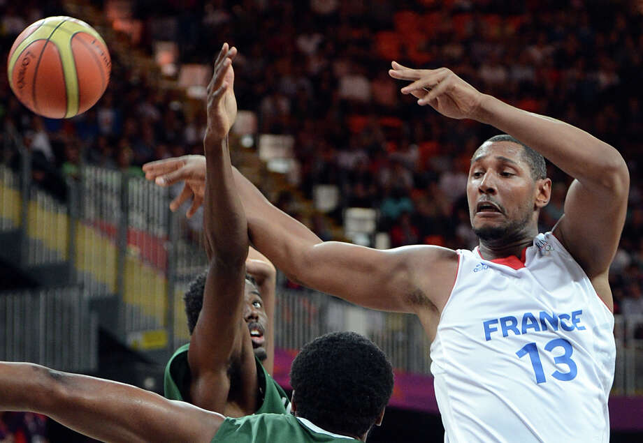 French forward Boris Diaw vies with Nigeria's defence during the men's basketball preliminary round match France vs Nigeria as part of the London 2012 Olympic Games at the Basketball Arena on August 6, 2012 in London. AFP PHOTO / MARK RALSTONMARK RALSTON/AFP/GettyImages Photo: MARK RALSTON, AFP/Getty Images / AFP