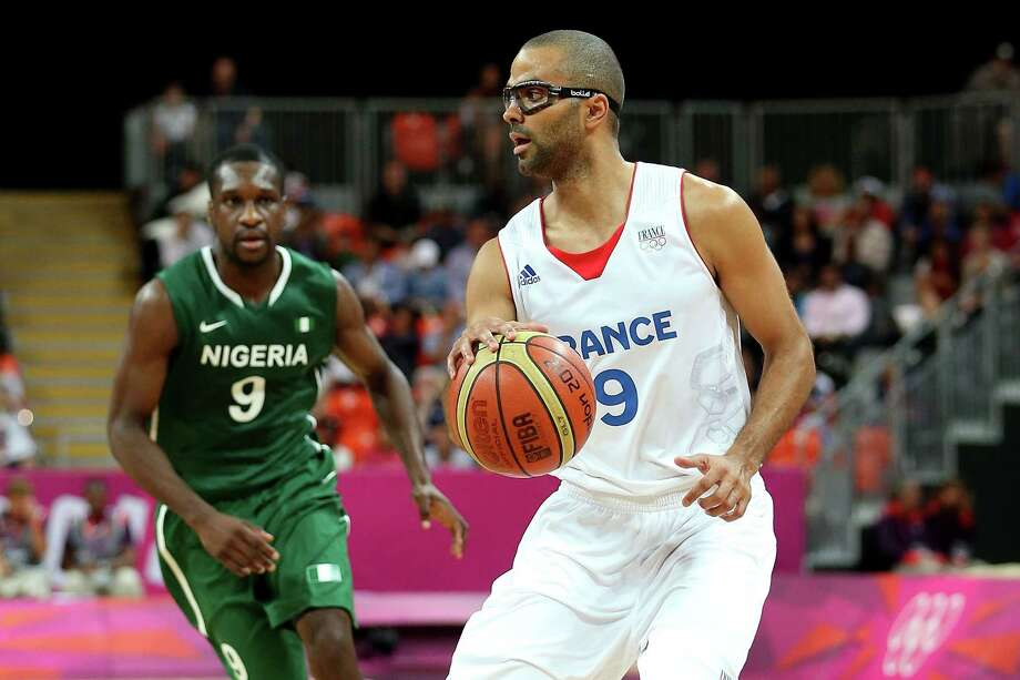 LONDON, ENGLAND - AUGUST 06:  Tony Parker #9 of France drives in the first quarter looks to pass the ball against Chamberlain Oguchi #9 of Nigeria during the Men's Basketball Preliminary Round match on Day 10 of the London 2012 Olympic Games at the Basketball Arena on August 6, 2012  in London, England. Photo: Christian Petersen, Getty Images / 2012 Getty Images