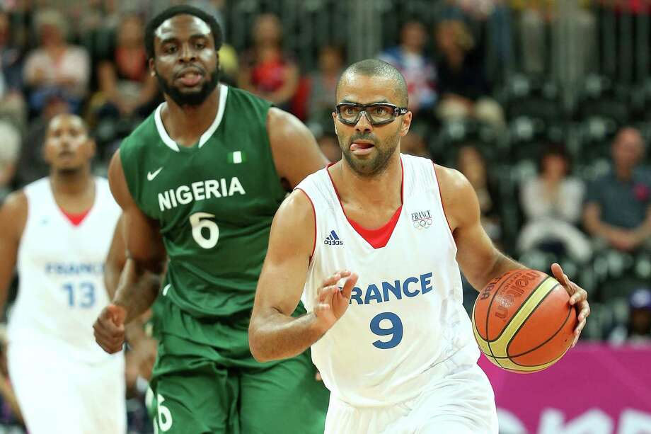 LONDON, ENGLAND - AUGUST 06:  Tony Parker #9 of France drives in the first half against Ike Diogu #6 of Nigeria during the Men's Basketball Preliminary Round match on Day 10 of the London 2012 Olympic Games at the Basketball Arena on August 6, 2012  in London, England. Photo: Christian Petersen, Getty Images / 2012 Getty Images