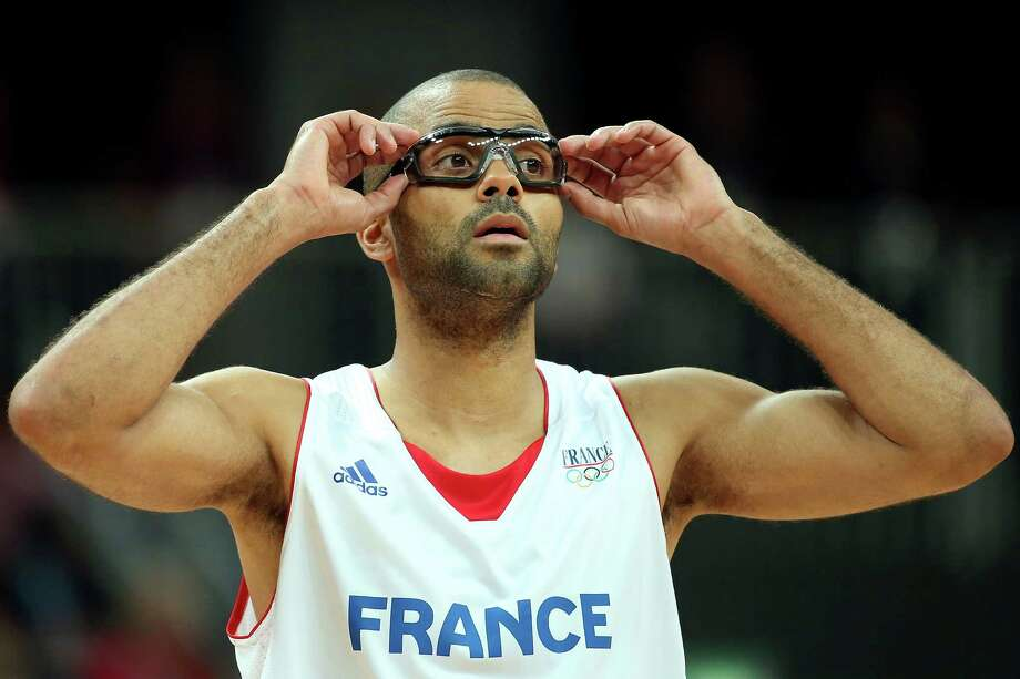 LONDON, ENGLAND - AUGUST 06:  Tony Parker of France asjusts his protective glasses as he looks on against Nigeria during the Men's Basketball Preliminary Round match on Day 10 of the London 2012 Olympic Games at the Basketball Arena on August 6, 2012  in London, England. Photo: Christian Petersen, Getty Images / 2012 Getty Images