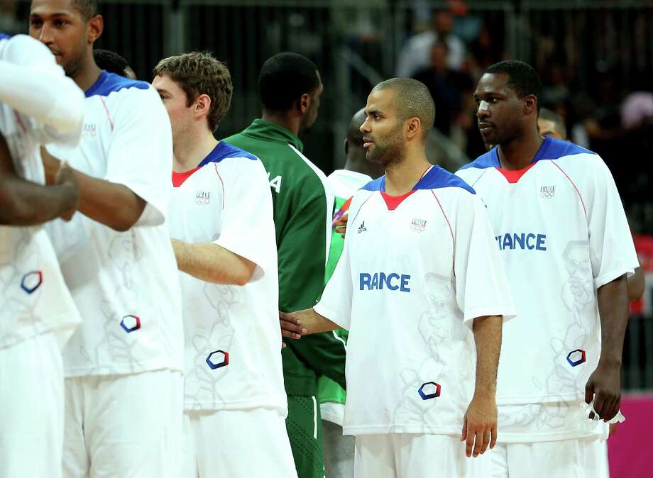 LONDON, ENGLAND - AUGUST 06:  Tony Parker #9 (C) of France is congratulated by players from Nigeria after France won 79-73 during the Men's Basketball Preliminary Round match on Day 10 of the London 2012 Olympic Games at the Basketball Arena on August 6, 2012  in London, England. Photo: Christian Petersen, Getty Images / 2012 Getty Images